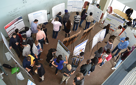 Students present original applied math research in the SIAM poster session.