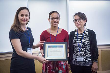 Professor Noemi Petra, left, and Professor Daniella Calvetti, right, present SIAM President Jessica Taylor, center, with a certificate of recognition.
