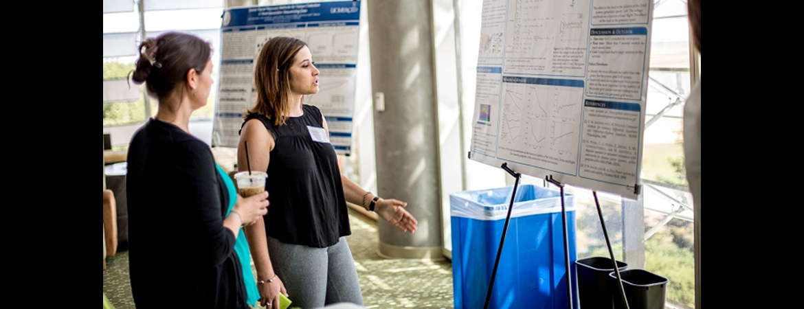 Undergraduate student presents her research poster.